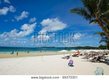 Samet Island - August 2015: Tourists sunbathe, swim and relax on beach having fun. Tourism is on