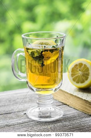 Green Tea With Lemon And Mint In A Glass Mug