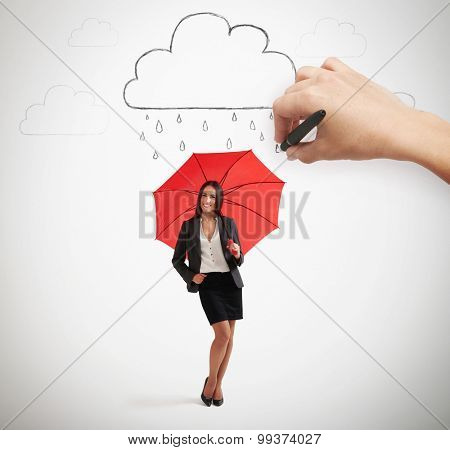 big hand drawing clouds with drops, smiley businesswoman with red umbrella standing under rain and looking at camera over light grey background
