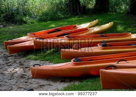 Kayaks On Lake Shore