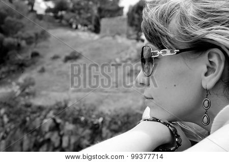 close up woman portrait of young woman with sun glasses