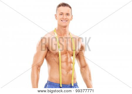 Handsome muscular man standing isolated on white background