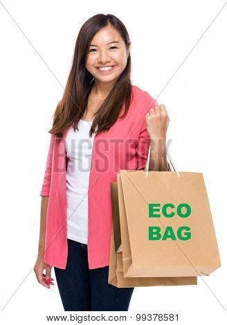 Happy woman with shopping bag and showing eco bag