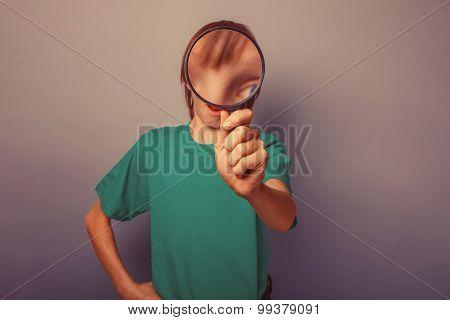 boy teenager European appearance brown hair in a shirt looking t