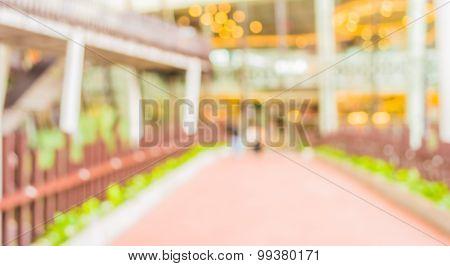 Blur Image Of People Walking At Long Corridor