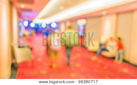 Blurred Image Of People At Cinema's Corridor