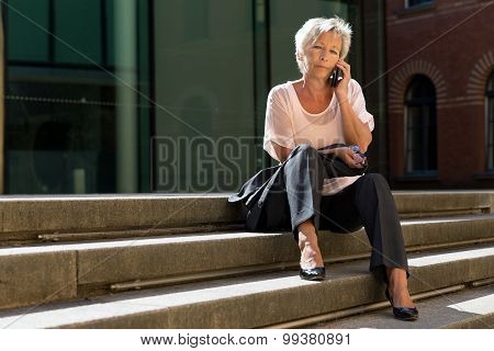 Older Business Woman Is Calling On Stairs