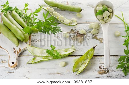 Fresh Broad Beans Over  Wooden Background.