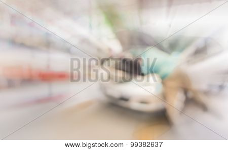 Blur Image Of Worker Fixing Car In Ther Garage
