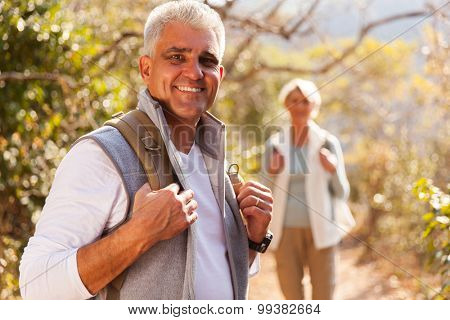 handsome senior man hiking with wife