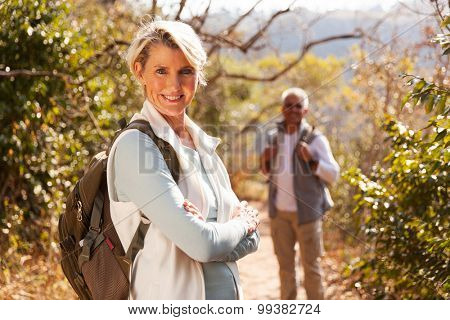 beautiful middle aged female hiker arms folded outdoors