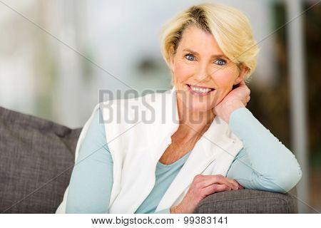 portrait of beautiful senior woman sitting indoors