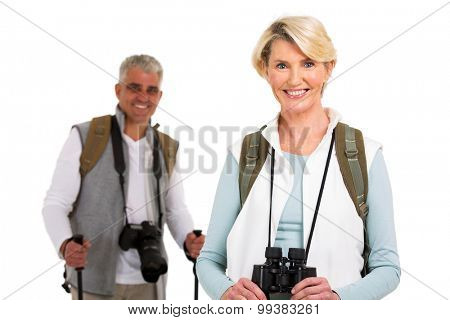 beautiful senior female tourist standing in front husband on white background