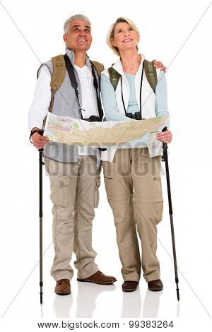 beautiful middle aged couple with backpacks and map on white background