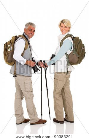 happy mid age  couple with backpacks looking back