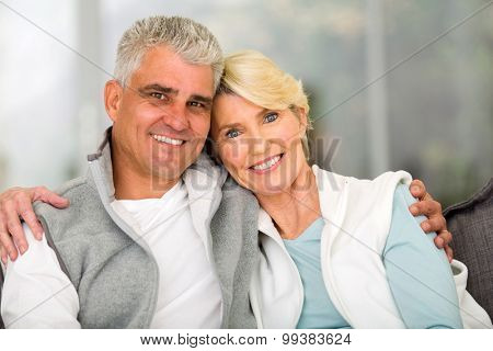portrait of happy mature couple relaxing at home