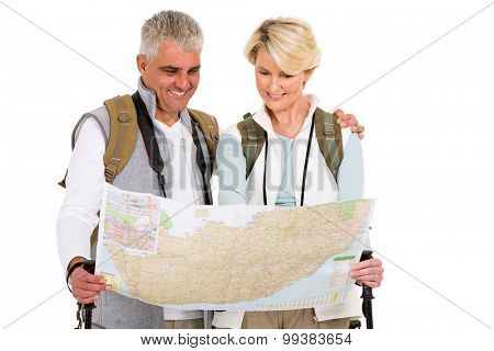 touring couple tourists checking directions on a map isolated on white