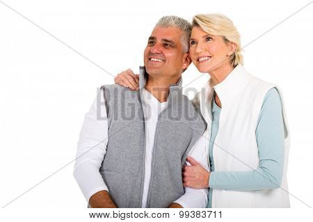 happy mid age couple looking up on white background