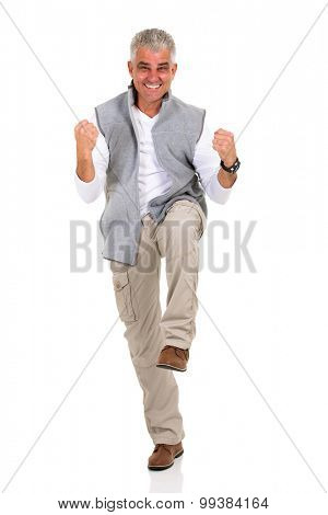 excited middle aged man holding fists on white background