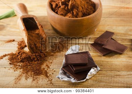 Chocolate Bars With A Bowl Of Cacao Powder.