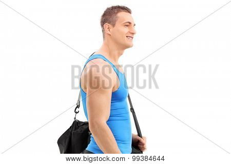 Young athlete carrying sports bag isolated on white background