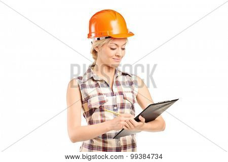 Female mechanic writing on a clipboard isolated on white background