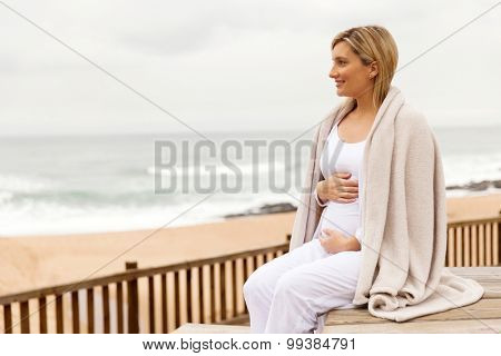 attractive pregnant woman at the beach