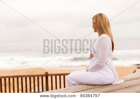 peaceful young pregnant woman relaxing outdoors