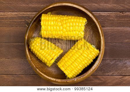 Grains Of Ripe Corn On Wooden Background