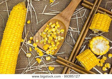 Grains Of Ripe Corn On Burlap Sack Background