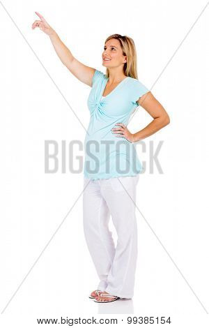 happy pregnant woman pointing at empty copy space