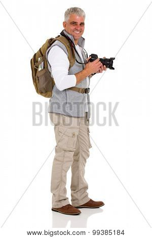 cheerful side view of senior male tourist on white background