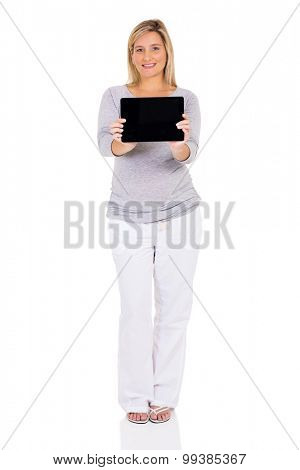 pretty pregnant woman showing tablet computer isolated on white background