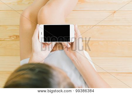 women using white smartphone