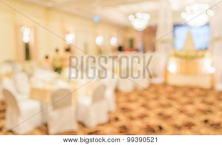 Blurred Image Of Large Dining Table Set For Wedding, Dinner Or Festival Event Inside Large Hall With