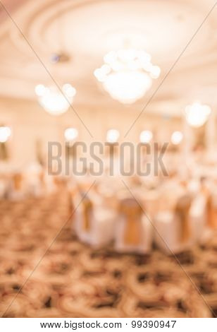 Blurred Image Of Large Dining Table Set For Wedding, Dinner Or Festival Event Inside Large Hall