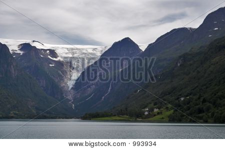 Mountains And Glacier Above The Lake
