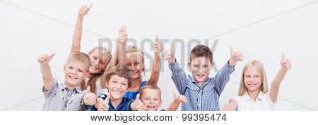Portrait of happy children showing thumbs up gesture