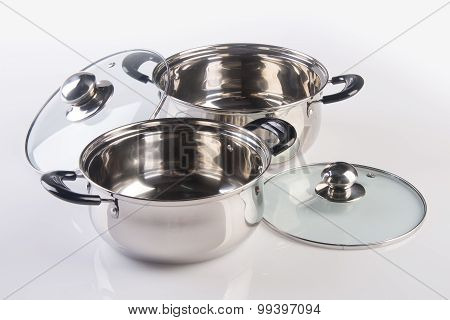Stainless Steel Pots On A Background