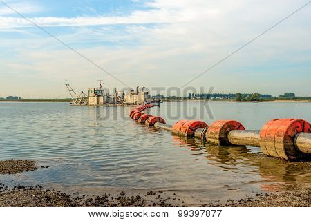 Floating Suction Dredge In The River