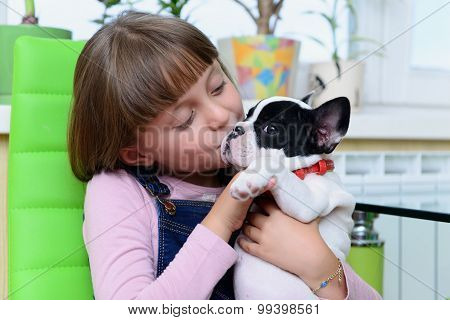 Girl With Bulldog Puppy