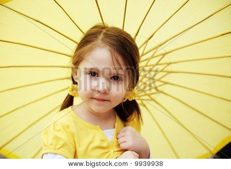 Girl with yellow parasol