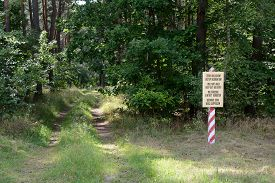 stock photo of no entry  - Military area keep out no entry sign in four languages - JPG