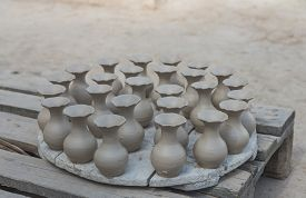 picture of pottery  - The group of wet pottery vase dry under the sun in pottery factory name Serghini Maitre Potier et Zellige Fassi in Fes Morocco - JPG