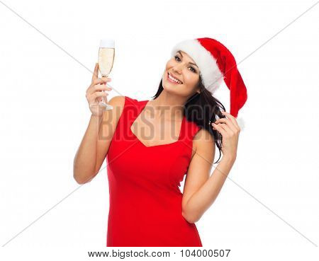 people, holidays, christmas and celebration concept - beautiful sexy woman in santa hat and red dress with champagne glass