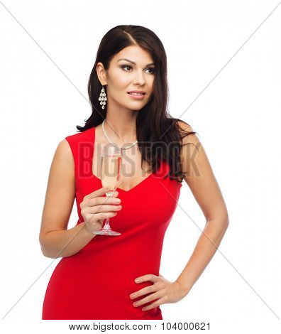 people, holidays, christmas and celebration concept - beautiful sexy woman in red dress with champagne glass