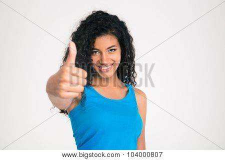 Portrait of a smiling afro american woman showing thumb up isolated on a white background