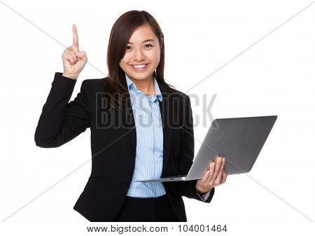 Asian Young businesswoman use of the laptop computer and finger up