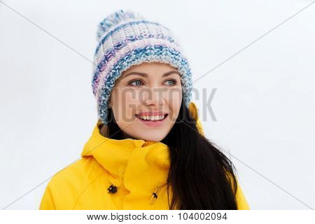 winter, leisure, clothing and people concept - happy young woman in winter clothes outdoors
