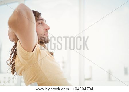 Side view of hipster relaxing in office